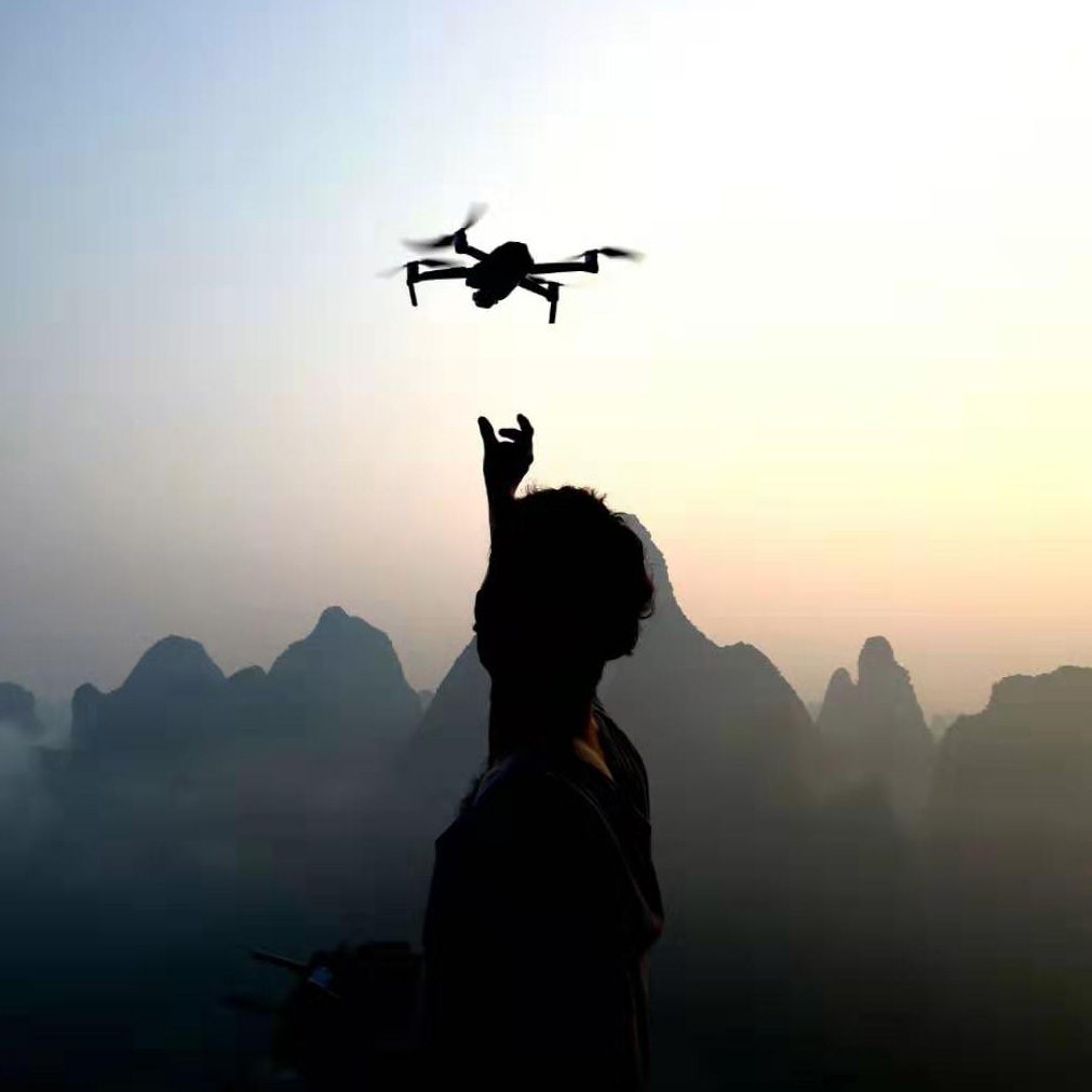 Scott flying his drone in Yangshuo